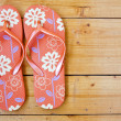 Flip flops on the wooden floor. — Stock Photo #6040963