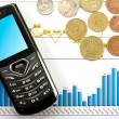 Royalty-Free Stock Photo: Phone  and coins over  business chart