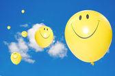 Yellow flying balloons. — Stock Photo