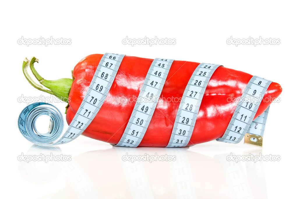 Healthy life concept. big pepper with a measure tape. — Stock Photo #6329972