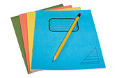 Color exercise books and pencil. — Stock Photo