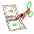 Scissors cuts one american dollar. — Stock Photo