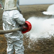 Fire in a silver protective suit. — Stock Photo #5449811