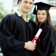 Couple in love graduate — Stock Photo