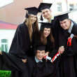 Stock Photo: Graduates rejoice and indulge