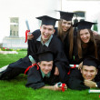 Students dabble in the grass, and rejoice - Stock Photo