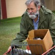 Homeless Man Cart - Stock Photo