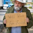 Begging With Sign — Stock Photo #5569354