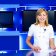 Television anchorwoman at TV studio - Stok fotoraf
