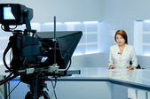 Television anchorwoman during live broadcasting — Stock Photo