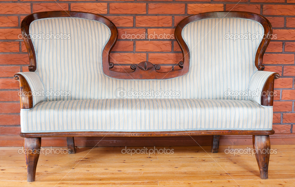 An old wooden upholstered sofa, handmade, with a fancy back — Stock Photo #6073175