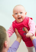 Baby in dads hands — Stock Photo