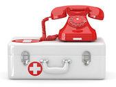 Helpline.Services. Phone on medical kit — Stock Photo