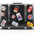 Stock Photo: Black leather suitcase with travel stickers.