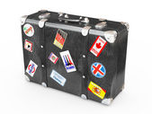Black leather suitcase with travel stickers. — Stock Photo