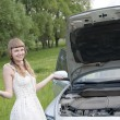 Worried woman with broken car - Stock Photo