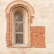 The antique window in stone wall — Stock Photo