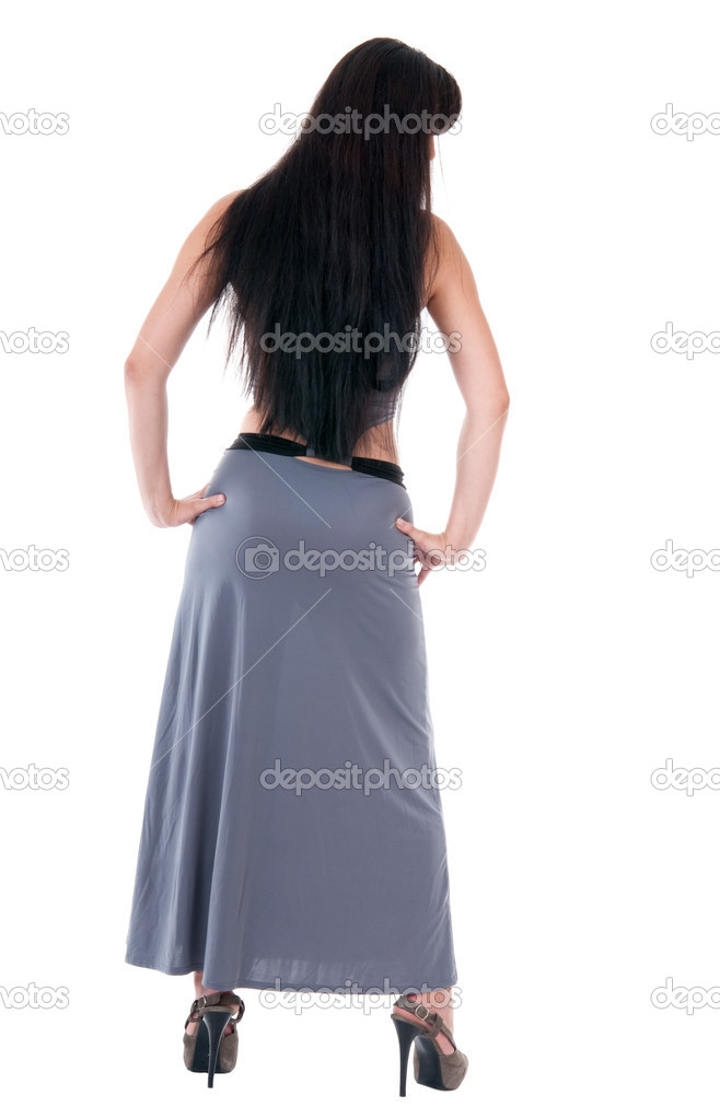 Woman in evening dress and high heels view from back isolated on white — Stock Photo #6614589