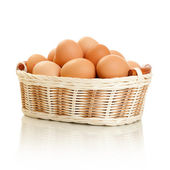 Eggs in basket isolated on white — Stock Photo