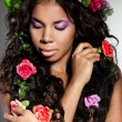 Elegant mulatto girl with circlet of flowers — Stock Photo