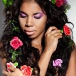 Elegant mulatto girl with circlet of flowers — Stock Photo