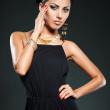 Elegant fashionable woman in black dress — Stock Photo