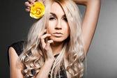 Elegant fashionable woman with rose — Stock Photo
