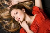 Pretty girl in red dress — Stock Photo