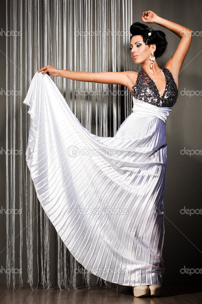Elegant fashionable woman in beautiful dress — Stock Photo #5419007