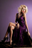 Beautiful fashionable woman in violet clothes — Stock Photo