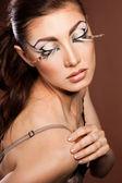 Modna kobieta z art visage — Zdjęcie stockowe