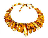 Baltic amber necklace isolated on white — Stock Photo
