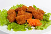 Battered fisn on a plate — Stock Photo