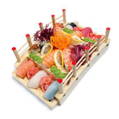 Set of sushi on wooden stand in the form of the bridge — Stock Photo