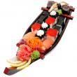 Set of sushi on wooden stand in the form of the boat — Stock Photo #5590215