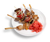 Skewers on a plate — Stock Photo