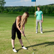 Golf woman player green putting hole golf ball — Stock Photo #6032913