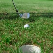 Golf club: ball close to the 18th hole — Stock Photo #6032919