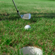 Golf club: ball close to the 18th hole — Stock Photo