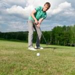 Golf green hole course man putting ball inside short putt — Stock Photo