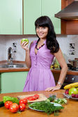 Beautiful woman cooking healthy food — Stock Photo