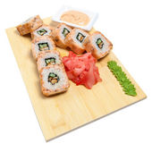 Rolled sushi on wooden stand — Stock Photo