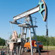 Oil pumping unit - Stock Photo