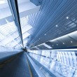 Stock Photo: Blue escalator in motion