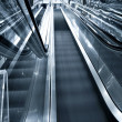 Royalty-Free Stock Photo: Blue escalator in motion