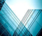 Modern glass skyscraper perspective view — Stock Photo