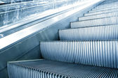 Blue escalator in motion — Stock Photo