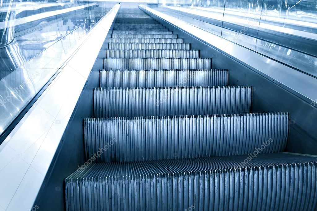 Blue escalator in motion — Stock Photo #5459778
