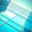 Modern blue glass skyscraper perspective view - Stock Photo