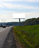 Empty blank billboard on the road — Foto Stock